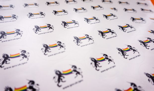 Stickers featuring the government crest and a rainbow flag