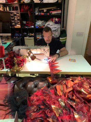Man working on sewing machine