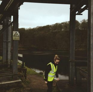 Rachel on site in a high vis